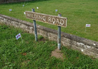 The wilding road sign, with the joint UK and Canadian flags.